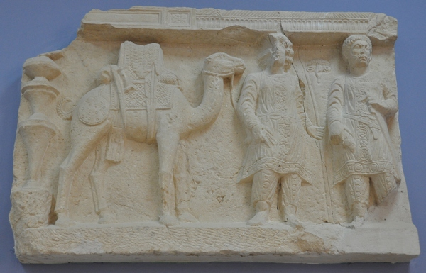 Palmyra, Diocletianic Camp, Relief of a dromedary, a merchant, and a soldier