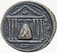 The baetyl of Elagabal on a coin from Emesa. An eagle protects the stone with its wings.