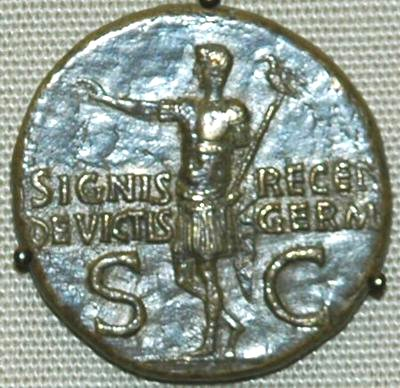 Germanicus returns with the recovered legionary standard (coin by his son Caligula)
