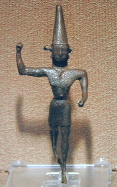 "Statuette of the ""smiting god"" from Dövlek. Museum of Anatolian Civilizations, Ankara (Turkey)."