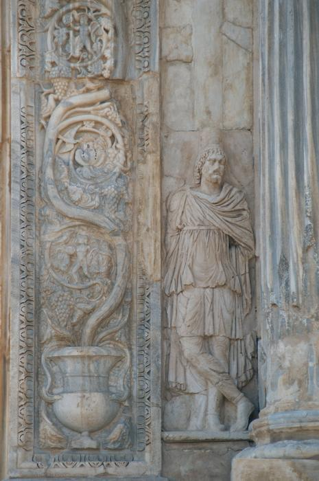 Lepcis, Arch of Septimius Severus, SW, barbarian (left)