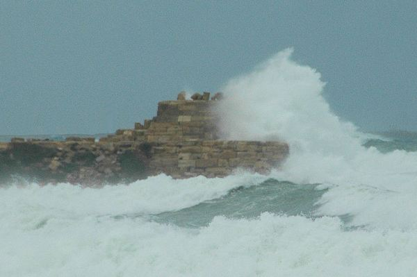Lepcis Magna, Port, ruins of the lighthouse in a storm