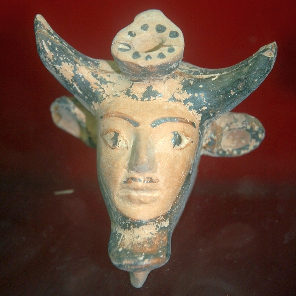 Taucheira, bottle in the shape of man with bull's horns
