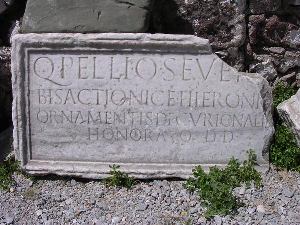 Latin inscription (AE 1973, 503) mentioning a honorary member of the decurional order.