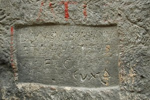 Inscription at the entrance of the tunnel: a dedication to Vespasian and Titus