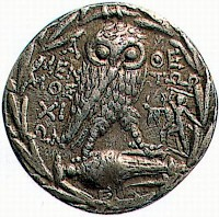 Athenian tetradrachm showing an owl and the statue of the Tyrannicides