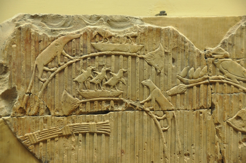 Relief of cats chasing birds