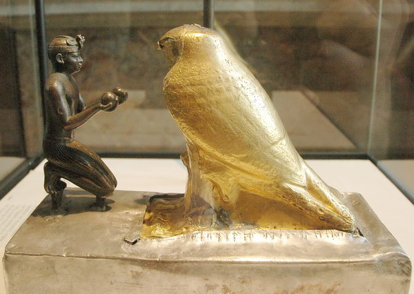 Taharqo venerating the falcon-god Hemen