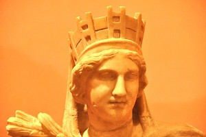 A mural crown on Tyche's head