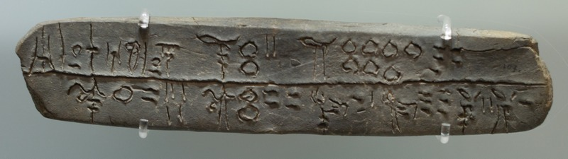 Linear-B tablet mentioning sheep, goats, oxen, and pigs being brought to a place called Si-ra-ro.