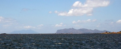 The Aegates Islands: Favignana (ancient Aegusa) to the right and  Maréttimo (Hiera Nesos) to the left in the distance.