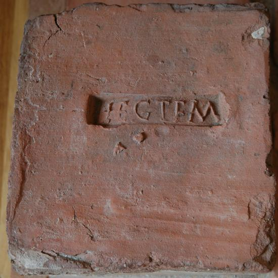 Tile with inscription LEG I F M (Legio I Flavia Minervia)