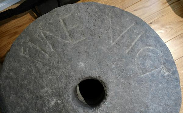 "Millstone with inscription FINES VICI (""town limits"")"